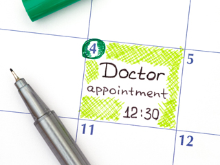 Calendar showing appointment with pen on top